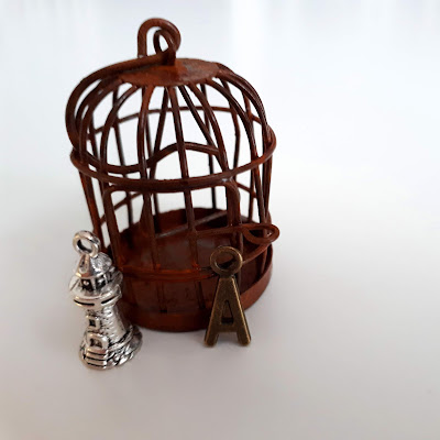 1/12 scale miniature aged birdcage with lighthouse and letter A charms.