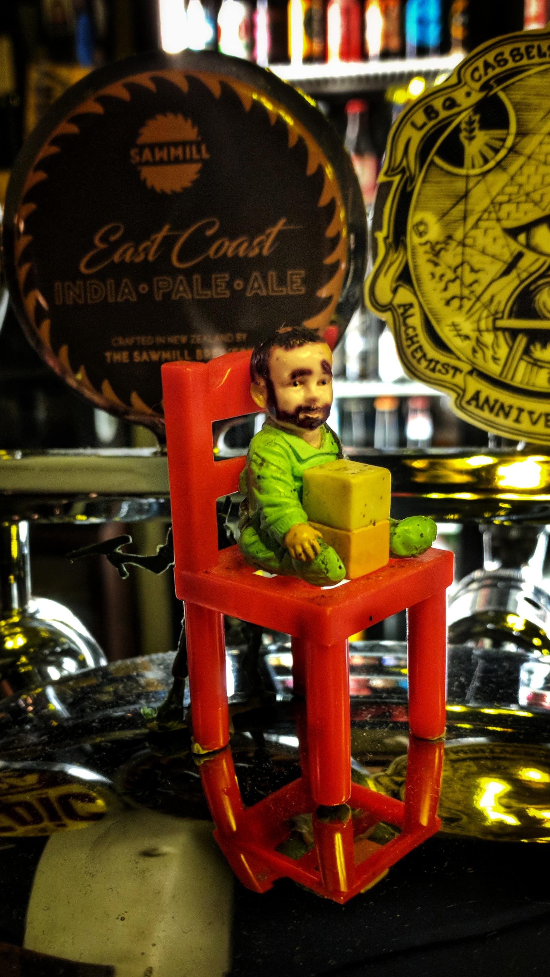 A figurine on the bar - caption that