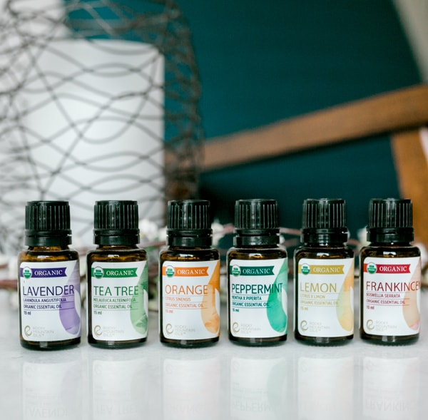 bottles of organic essential oils from Rocky Mountain Oils - lavender, tea tree, orange, peppermint, lemon and frankincense