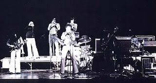 The Band at the 1973 Trumpet Symposium in Denver. Notice Lynn Nicholson reading the music behind Bill.