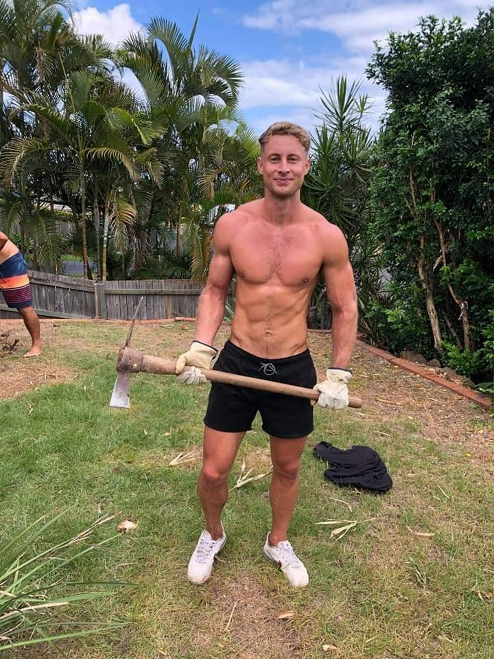 strong-bare-chest-blond-guy-backyard-work-smiling-muscle-hunk