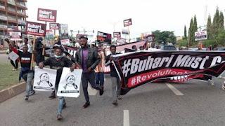 BREAKING: 'Buhari Must Go' Protesters Set Bonfires On Abuja Airport Road