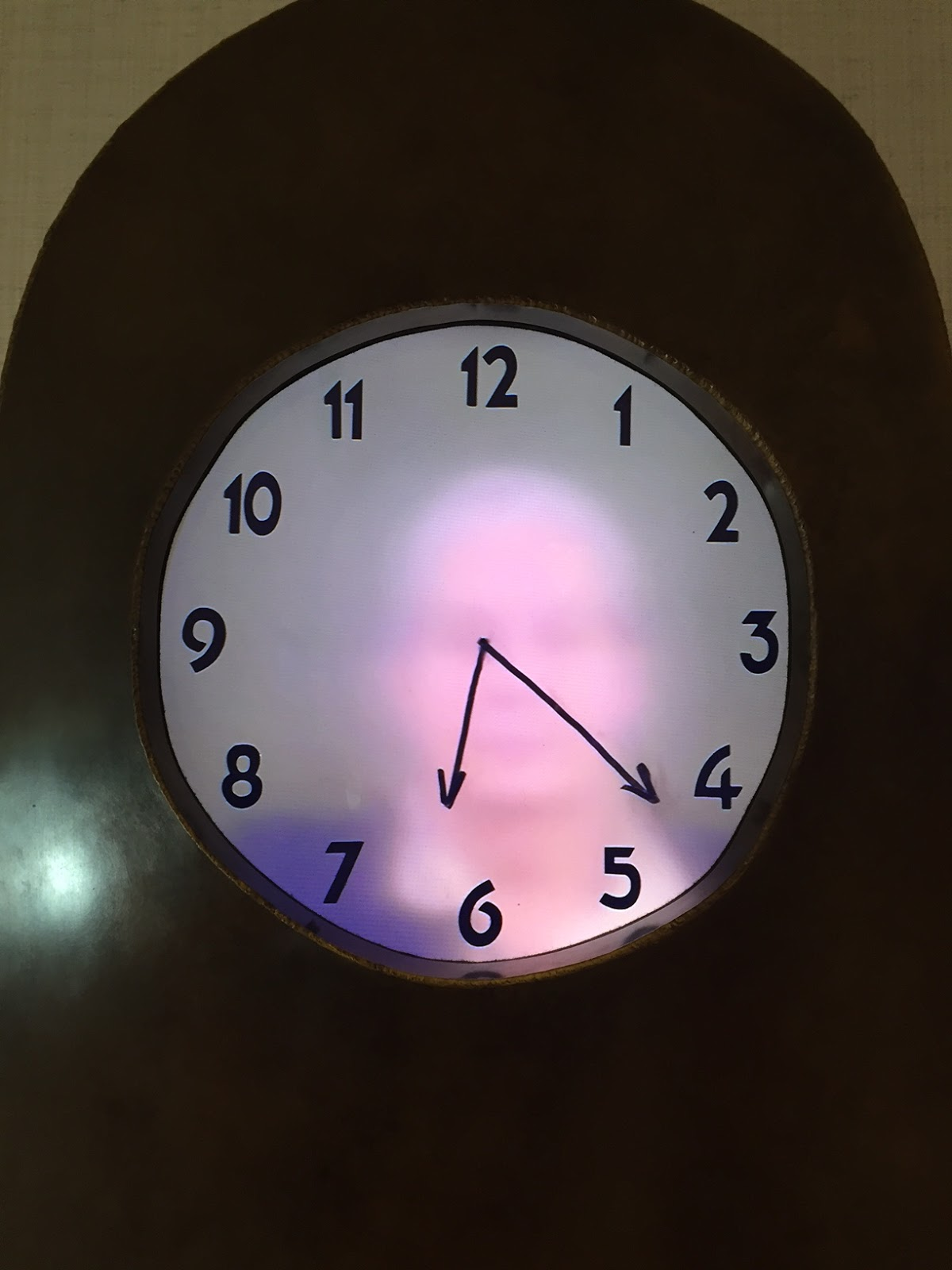 as we stood in silence observing this interactive grandmother clock i was compelled to look behind the clock to believe what i was seeing