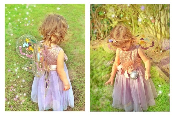 child in fairy dress wearing fairy wings made with contact paper and dried pressed flowers