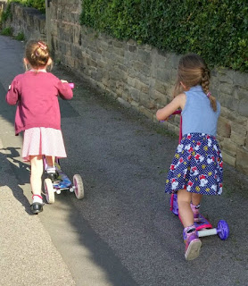 the girls scoot to school