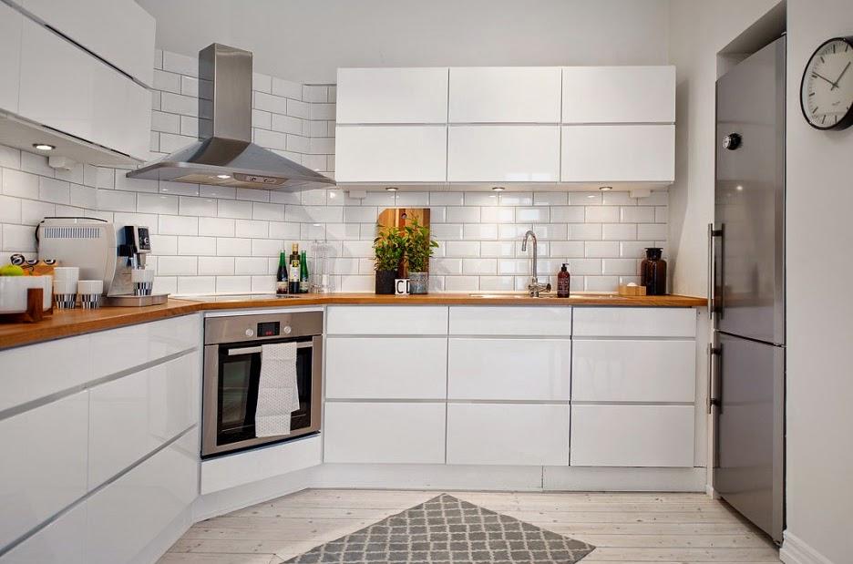 Una casa encantadora decorada en blanco - Casas bien decoradas ...