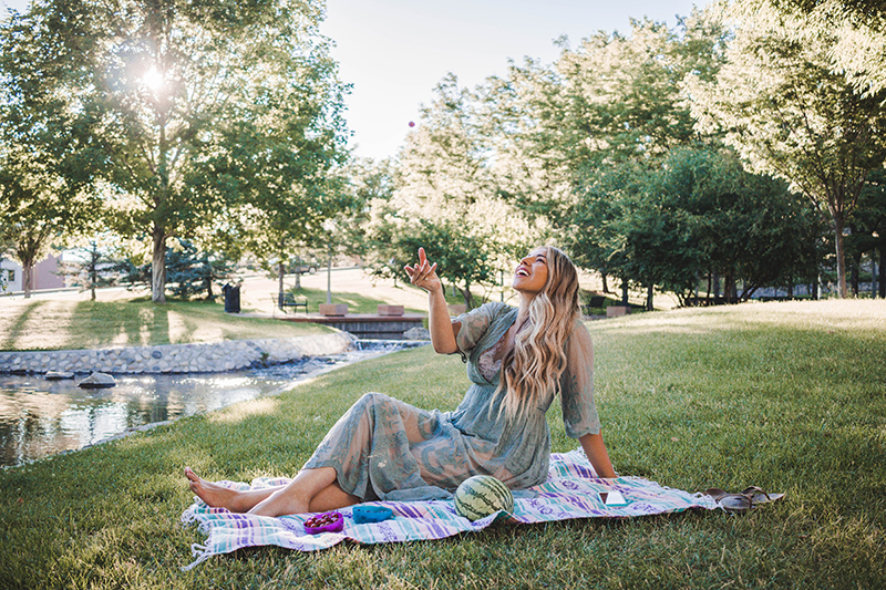 photo of person catching grapes, picnic blanket, globally sourced