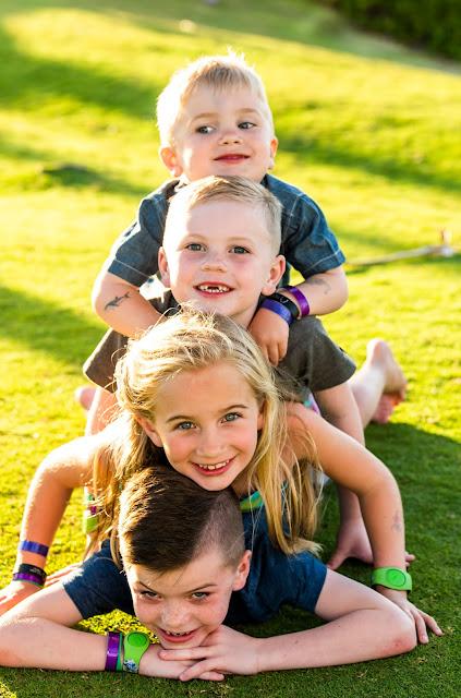 kids stacked up having fun