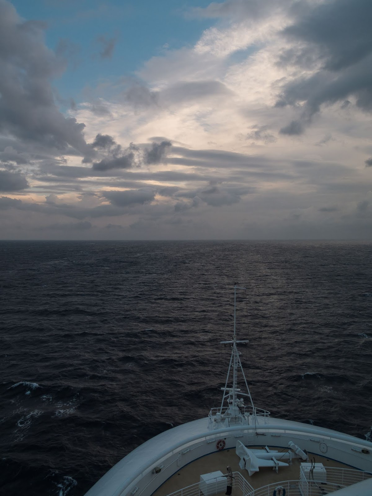 View of the water and sky while sailing on a cruise ship.