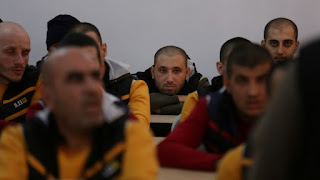 Former ISIS members sit in a classroom at the Syrian Center for Combating Extremist Ideology.KHALIL ASHAWI / REUTERS