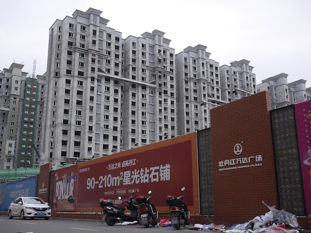 wall bordering construction site for a section of the Mudanjiang Wanda Plaza in China
