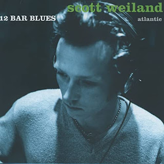 Scott Weiland wearing headphones on record cover