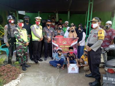 Pemberian Paket Sembako Brimob Jambi Kepada Masyarakat Dalam Rangka Peringatan Hari Bhayangkara Ke-74