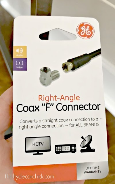 Angled cable connector to get furniture against wall