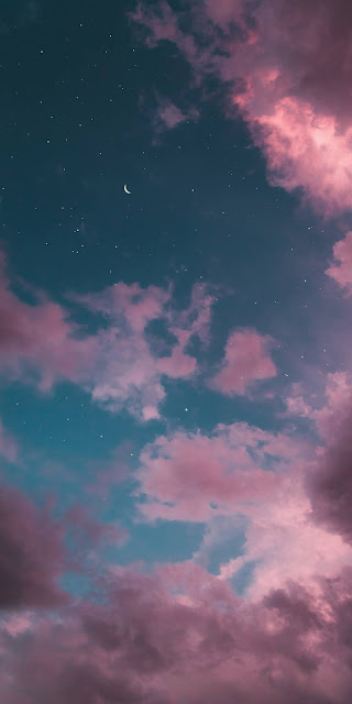 Crescent moon in the starry and pink sky