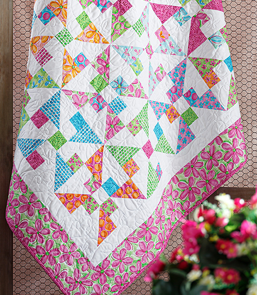 Pinwheel Frolic Quilt designed by Jenny of Missouri Quilt Co