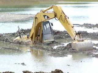digger stranded in water