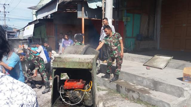 Kebersaman TNI-Masyarakat Gotong Royong Cor Jalan Raya