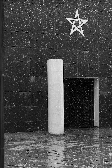 A Minimalist Photo of a Star Sign at Jawahar Kala Kendra as seen from the entrance gate during a Rain shower.
