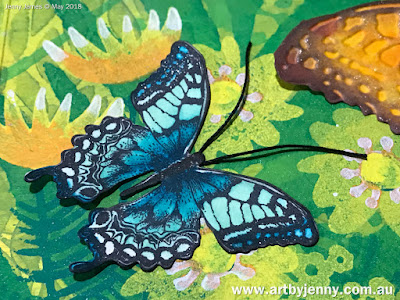 butterflies art journal page using stamps and other mixed media craft supplies