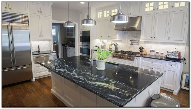 black kitchen countertops white cabinets