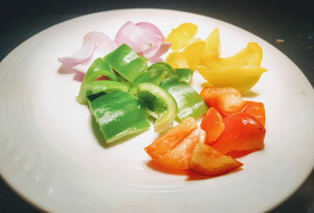Diced onions capsicum red yellow bell pepper for chilli paneer recipe
