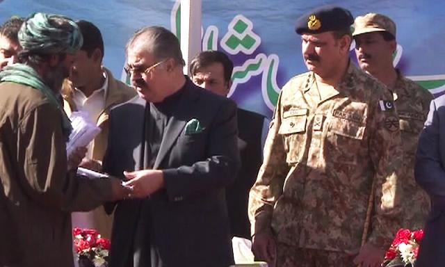 A suspected militant surrenders before Balochistan Chief Minister Nawab Sanaullah Zehri.— DawnNews