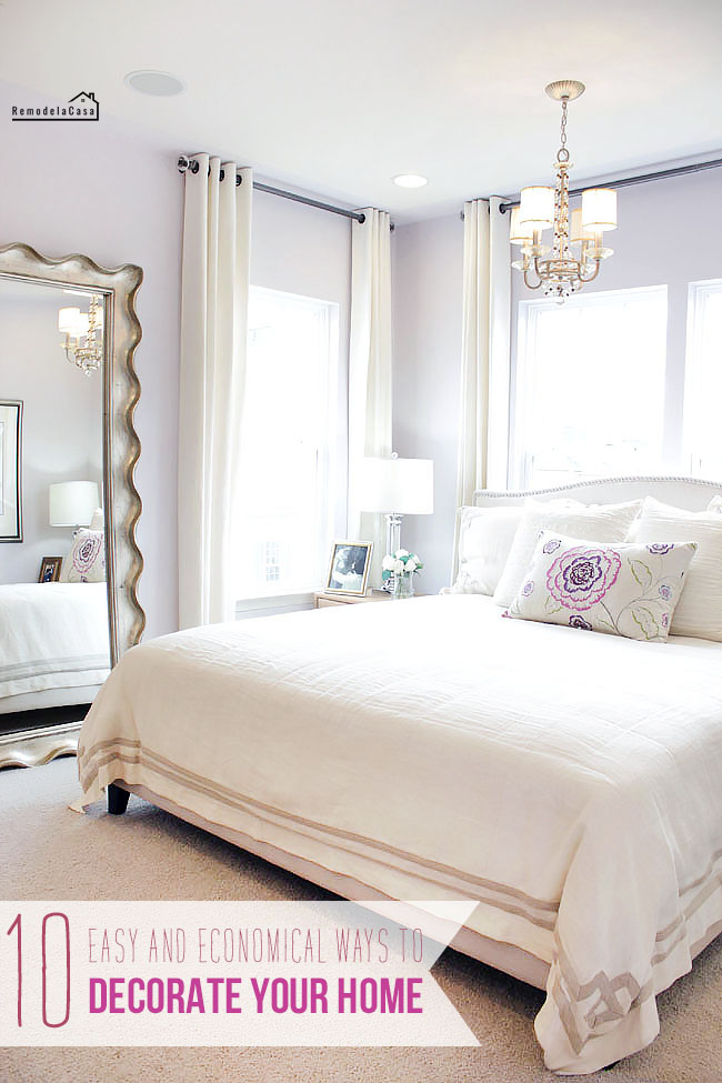 lilac bedroom wall with huge mirror and white curtains and bedding