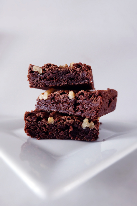 stack of chewy brownies on plate