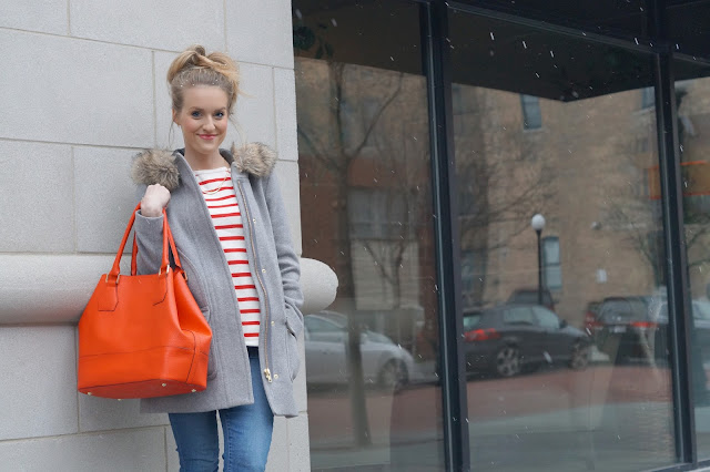 red striped sweater and tote