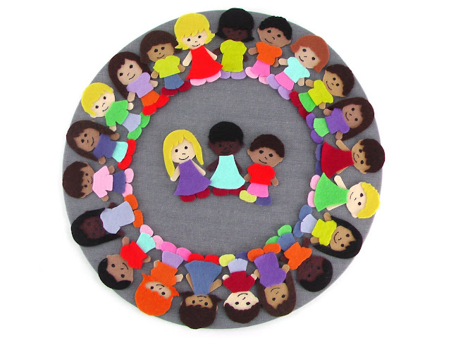 felt children on a gray circle background