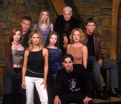 Group shot of actors portraying Buffy, Dawn, Xander, Willow, Tara, Anya, Riley, Giles, and Spike from Season Five