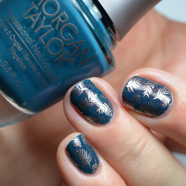teal nail polish with gold frond stamping and red shimmer swatch