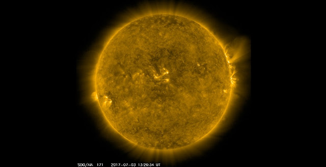 Image of the sun in 171 angstrom as seen by NASA's SDO on 3rd July 2017. This channel is especially good at showing coronal loops - the arcs extending off of the Sun where plasma moves along magnetic field lines. The brightest spots seen here are locations where the magnetic field near the surface is exceptionally strong. Credit: NASA / SDO.