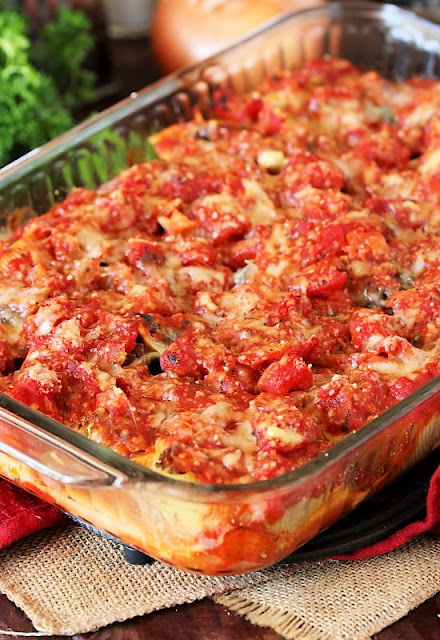 Baking Dish with Ground Beef Stuffed Shells Covered with Sauce Image
