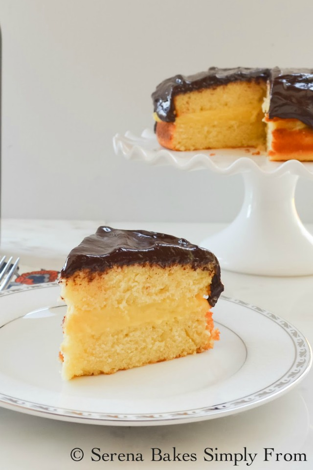 Boston Cream Pie recipe with vanilla pastry filling covered in chocolate ganache.