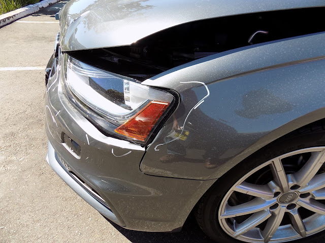 Close up of damage to 2016 Audi A4 before repairs at Almost Everything Auto Body.