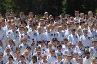 A group picture of the the Colorado Taekwondo Institute students at the Moo Sul Kwan Summer Expo
