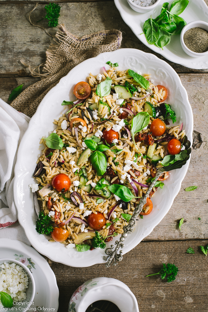 This delicious pasta salad is served in a oblong white platter.
