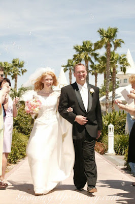 couple exiting Disney's Wedding Pavilion, palm trees, Growing Up Disney