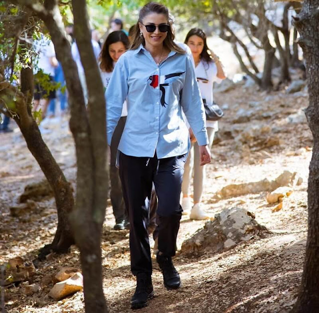Queen wore her Salomon hiking shoes, Saint Laurent sunglasses and Nike pants, She wore a new embroidered blue shirt