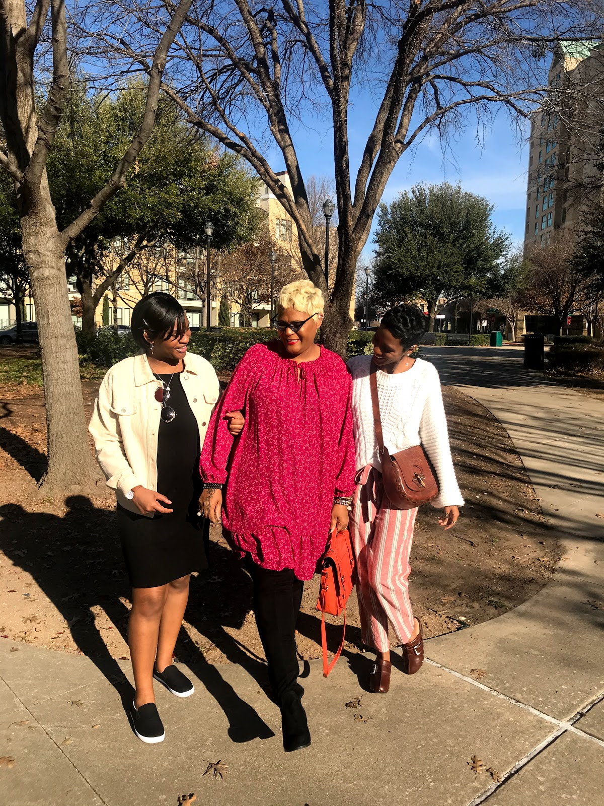 Tangie Bell taking picture and chatting about growing older with her daughters Carey and Kamoriae