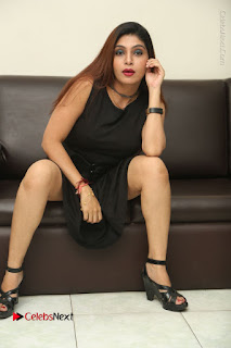 Tollywood Upcoming Actress Pooja Roshan Stills in Black Short Dress at Plus 1 Movie Trailer Launch  0286.JPG