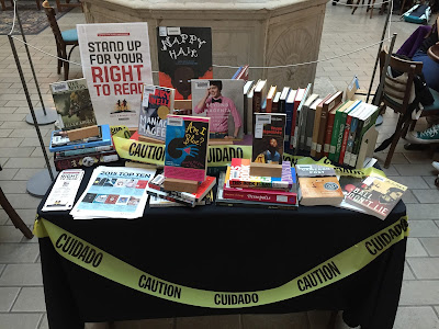 Display of banned books in library atrium.