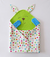 http://sewtoy.com/free-toy-sewing-pattern/cute-and-colorful-baby-blanket-and-baby-toy-all-in-one/