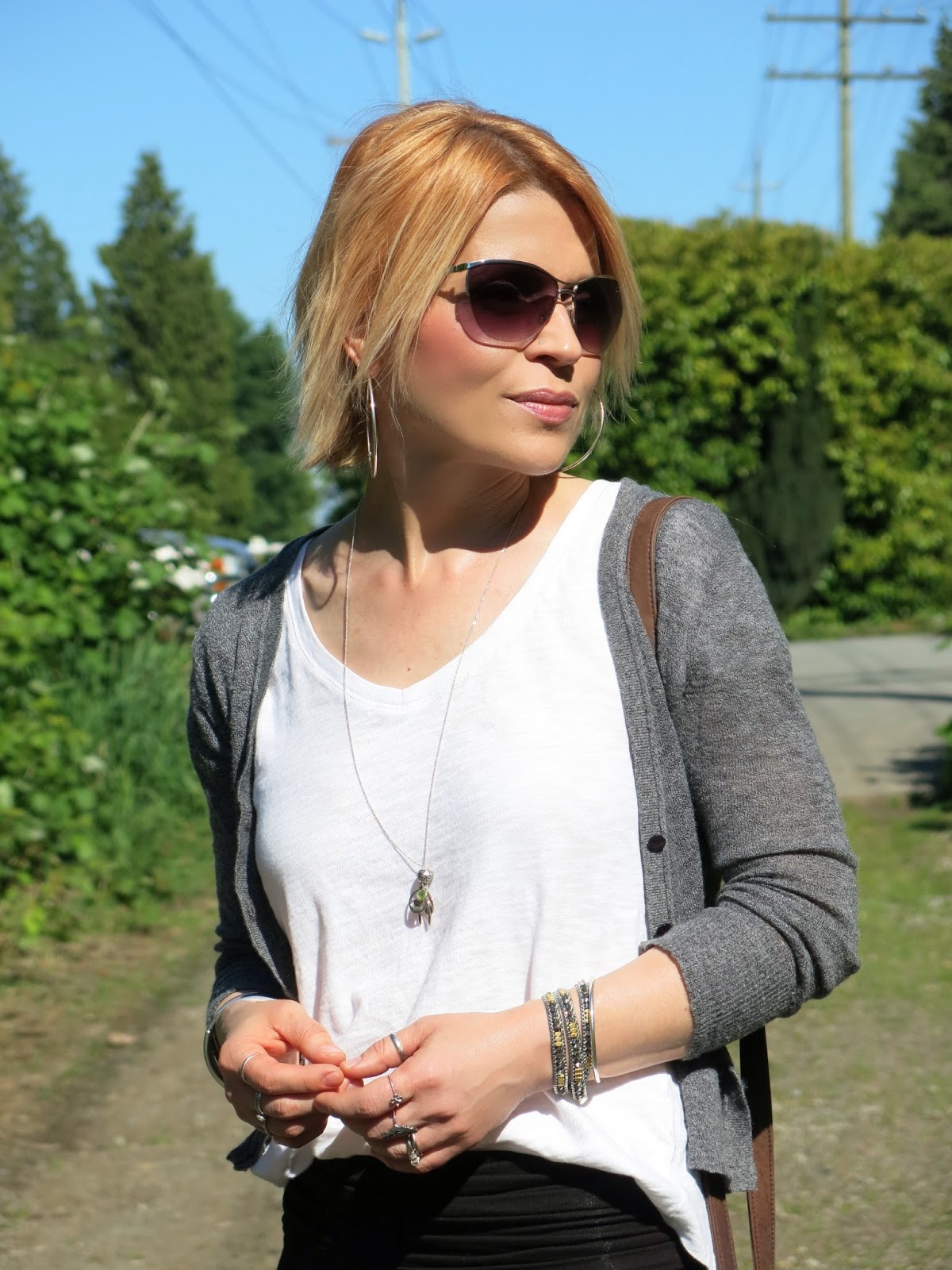 slouchy white tee, shrunken cardigan, sunglasses