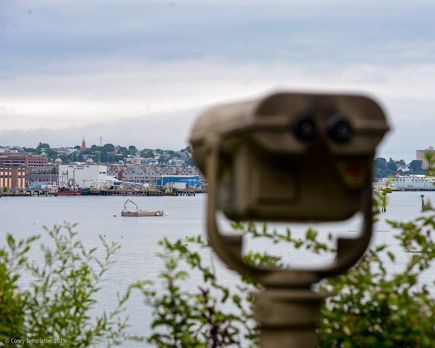 Portland, Maine USA August 2019 photo by Corey Templeton. Keeping an eye on the waterfront and Munjoy Hill, from across the Casco Bay Bridge.
