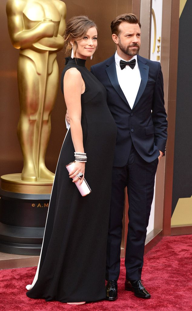 Olivia Wilde in a black Valentino dress with Jason Sudeikis at the Oscars 2014