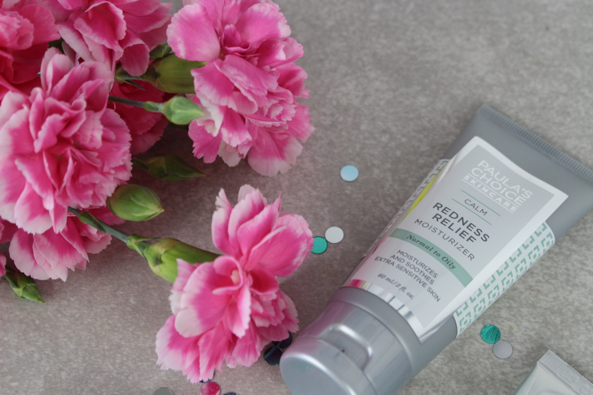 This is a close up of Paula's Choice skin care, surrounded by beautiful pink flowers.