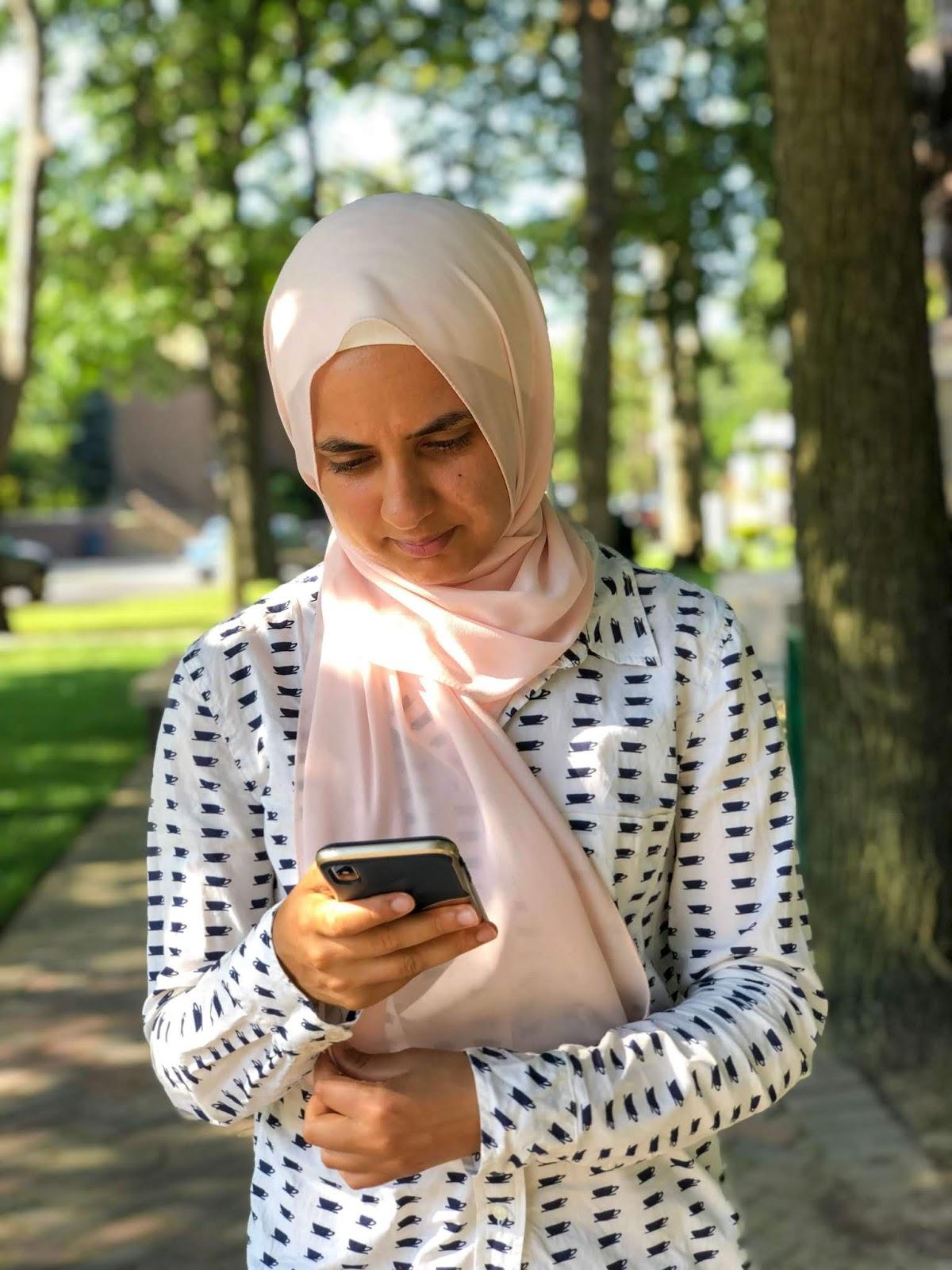 Sahara focusing on her phone on social media